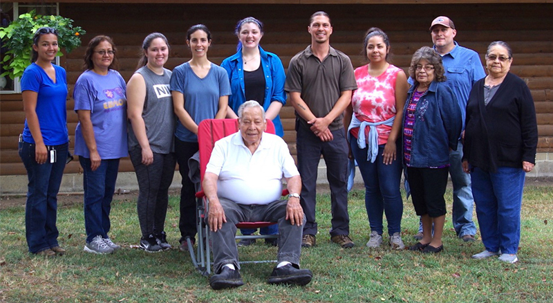 Clint Carroll, students and mentors at the home of elder and spiritual leader Crosslin Smith. From left, Feather Smith-Trevino, Nancy Scott, Kakiley Workman, Summer Wilkie, Savannah Anderson, Carroll, Sky Wildcat, Phyllis Edwards, Larry Carney, Anna Sixki