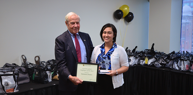 President Bruce Benson presents Stephanie Sheldon with her award.