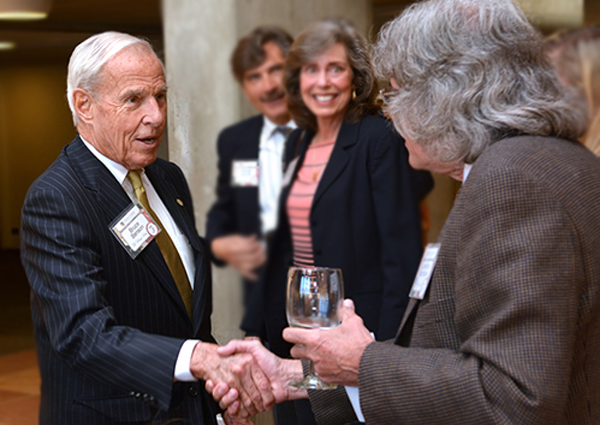 CU President Bruce Benson greets Heritage Society members last week at Denver Botanic Gardens.