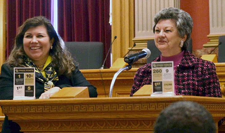 Tanya Kelly-Bowry, left, and Norma Anderson speak to CU Advocates who gathered Friday at the Capitol