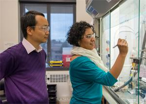 Hang Hubert Yin with Rosaura Padilla-Salinas, a postdoctoral associate in his lab.