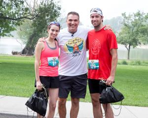 DeCrosta congratulates winners of CU Health Plan's 2016 5k Fun Run event.