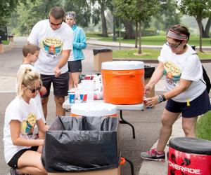 DeCrosta and the CU Health Plan Team staffing a water station at the Plan's 2016 5k Fun Run event.