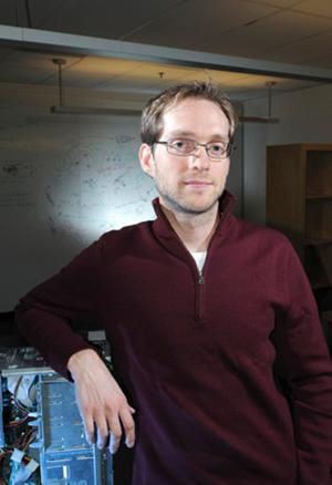 Photo of Aaron Clauset in his lab