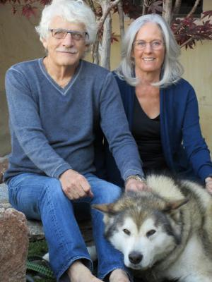 "Linda Shoemaker with her husband, Steve, and their Alaskan Malamute Kodiak. ""I lived on Kodiak Island when I was a child and have a great fondness for Alaska,"" she says. ""We go there often."""