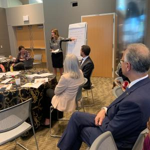 Regent Heidi Ganahl summarizes discussion points during a roundtable session engaging regents, President Mark Kennedy and other CU leaders.