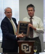 John Harner, UCCS, receives the Thomas Jefferson Award from CU President Bruce Benson.