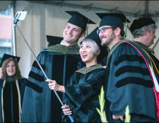 More than 1,000 graduates receive degrees on damp spring day at CU Anschutz