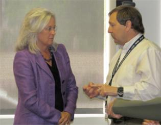 Regent Linda Shoemaker talks with Faculty Council member David Port after last week's council meeting.