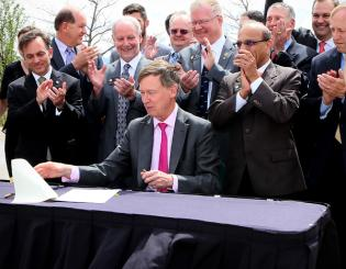 Governor Hickenlooper signs cyber bill into law at UCCS ceremony