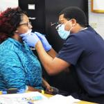 Visionary health fair serves migrant families, Urban Underserved Track's after-school activities build community wellness