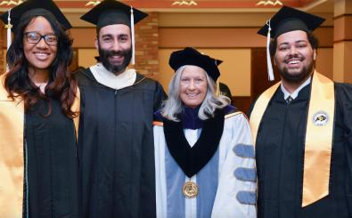 Regent Linda Shoemaker with CU Boulder student leaders at a 2016 graduation ceremony.