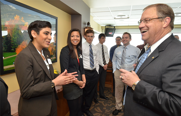 From left, CU-Boulder students Geneva Sanchez, Alyssa Faustino, Cort Wernz, Brandon Lin, Lorenzo Herrera and David Thayer speak with Phillips 66 CEO Greg Garland, who visited the campus Tuesday. (Photo: Casey A. Cass/University of Colorado Boulder)