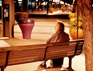 A homeless man sits on a bench on the 16th Street Mall in Denver. Photo by Chris Palmer.