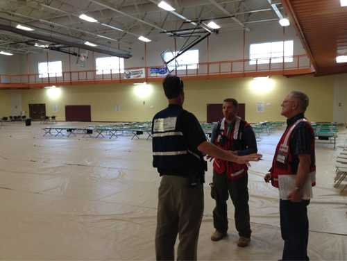 Tim Stoecklein met with Red Cross officials about converting a court into a evacuation shelter.