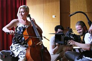 Megan Knapp, left, plays the cello while Pablo Barron, director of photography for Futuristic films — and a CU-Boulder graduate — films her for a CU system TV commercial promoting the university. The spot will air during televised CU football and basketball games. Photo by Clay Evans.