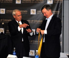 Photo: Cathy Beuten/University of Colorado With the gift of a necktie, CU President Bruce D. Benson helps Gov. John Hickenlooper show some school color during Monday