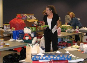 Heidi Schwab, general professional in the Office of Financial Aid, prepares gift baskets for donation to needy students as part of the Holiday Service Project.