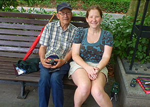 Lisa Sabella, a CU Denver graduate student in the College of Architecture and Planning, sits with a Chinese man in one of the Shanghai parks in which Sabella conducted research for her thesis.