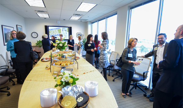 Members of CU's Advancement team on Dec. 4 welcomed more than 100 visitors to an open house at new office space in Broomfield. (Photo: Patrick Campbell/University of Colorado)